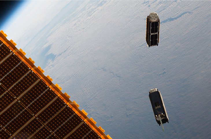 Photograph showing two artificial satellites.