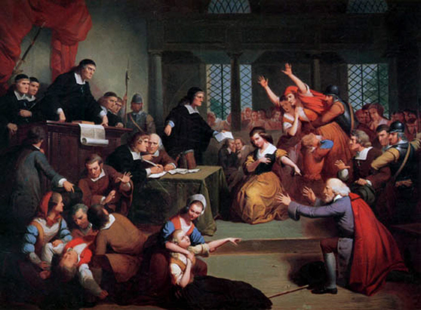 A painting of a trial of a colonist accused of witchcraft, showing people who have fainted and others in seeming fits of hysteria.