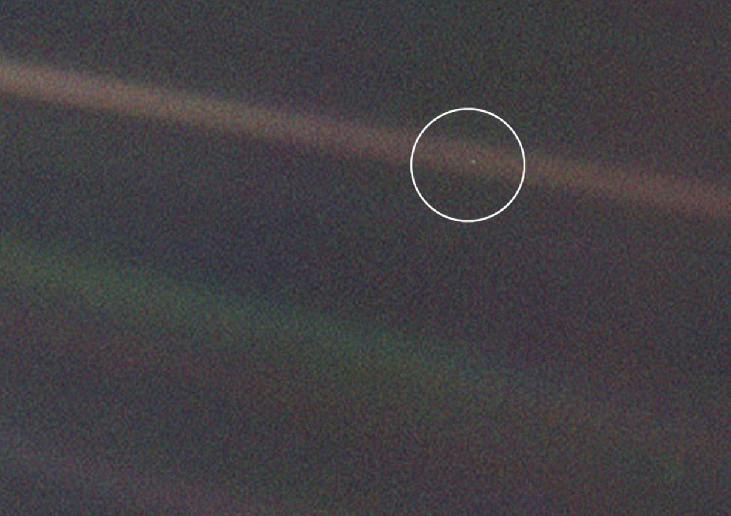 Earth from 4 billion miles. The Earth (circled) appears as a mere speck of light in this Voyager image. No signs of life, or any surface features at all, are evident.