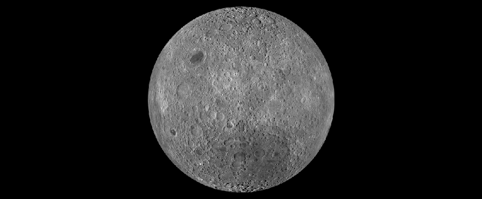 """Image of the Moon taken by the Lunar Reconnaissance Orbiter. This composite image shows the Lunar surface not seen from Earth. This region is so heavily cratered that most overlap. Only one small mare (Lunar """"sea"""") is seen at upper left."""