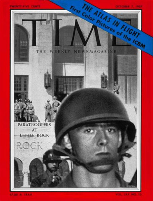 The cover of Time magazine features a close-up of a soldier in uniform. The school is in the background with multiple soldiers standing in front of it. The cover reads