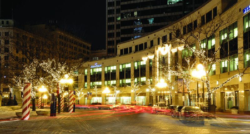 This image shows the Anthem Inc. building lit up at night.