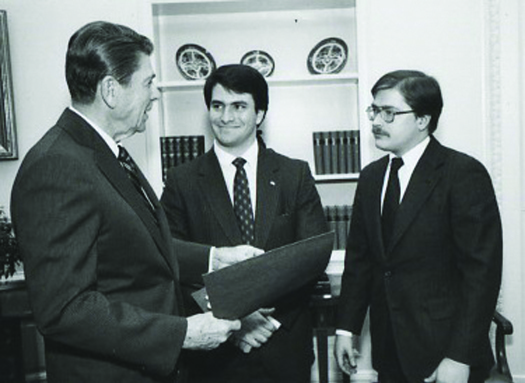 An image of Jack Abramoff standing between Ronald Reagan and Grover Norquist.