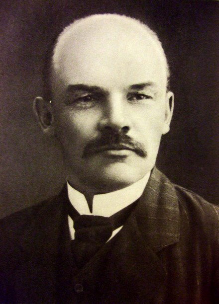 In figure (a), a photograph of Vladimir Ilyich Lenin is shown.