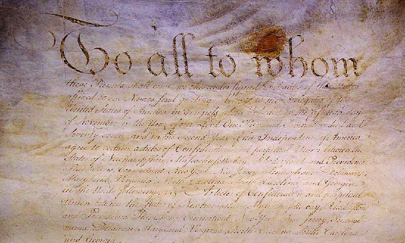 An image of an original handwritten version of the Articles of Confederation.