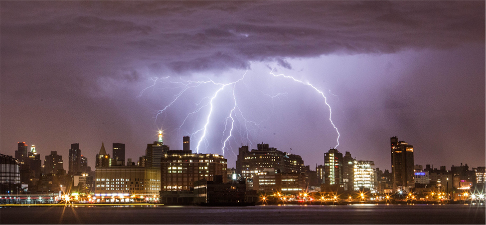 The photo shows lightning strike over several buildings.
