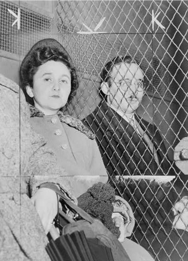 Ethel and Julius Rosenberg separated by a wire screen