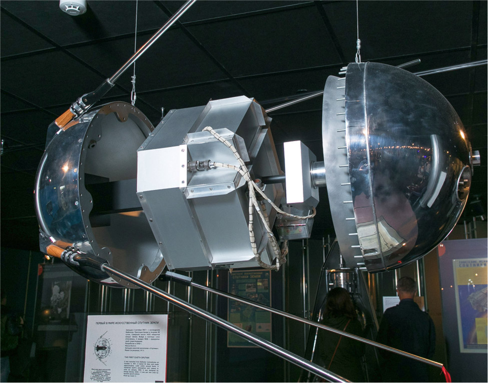 The spherical capsule is opened to show a cube inside.