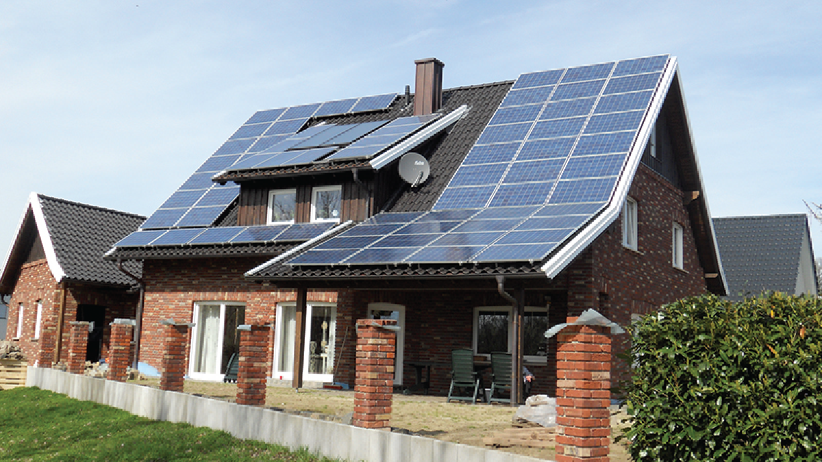 A house with a roof covered with solar panels.