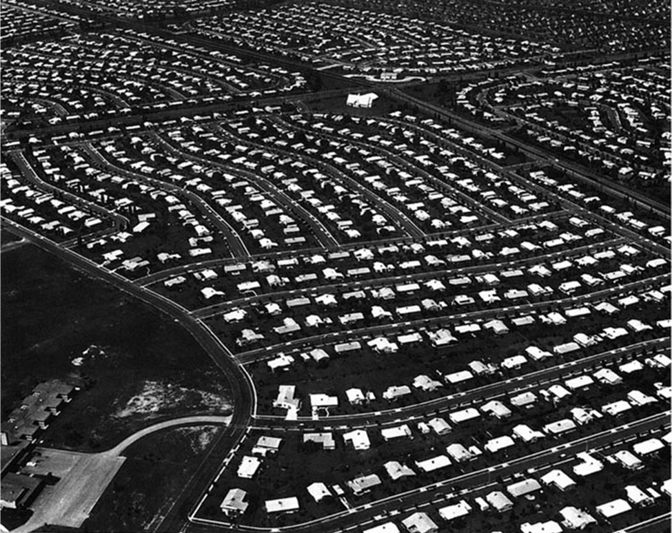 An aerial view of rows of houses and streets.