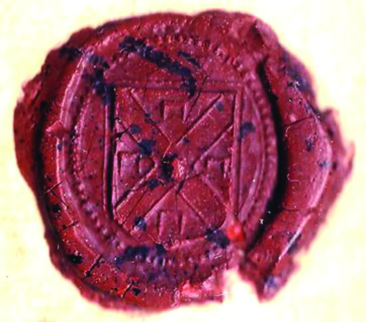 A photograph of a stamped wax seal of a coat of arms.