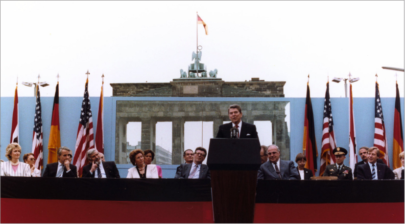 Ronald Reagan delivers a speech in front of the Brandenburg Gate and Berlin Wall.