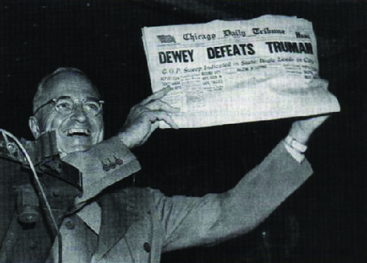 "Photo shows Harry S. Truman displaying a newspaper whose headline states ""Dewey Defeats Truman."""
