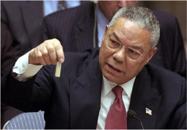 Colin Powell holds a model vial of anthrax while addressing the United Nations.
