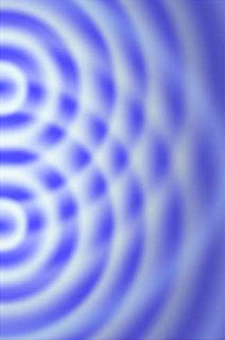 A photograph of an interference pattern is shown. Waves visible as white circles on the blue surface emanate from two centers and intersect at the numerous points.