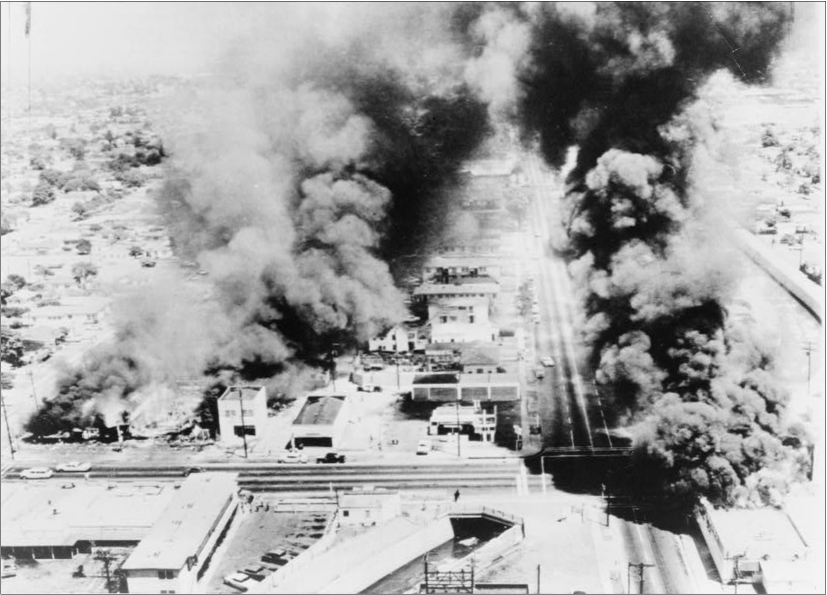 A bird's eye view of the city covered in smoke from burning buildings.