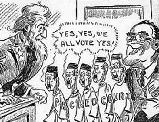 "An illustration of seven people. On the left is an Uncle Sam figure. On the right is a person in a suit with a wide grin and glasses. In between the two people are five people in robes. Letters across all of the robes read ""Packed Court"". A speech bubble above the five people in robes reads ""Yes, Yes, we all vote yes!""."