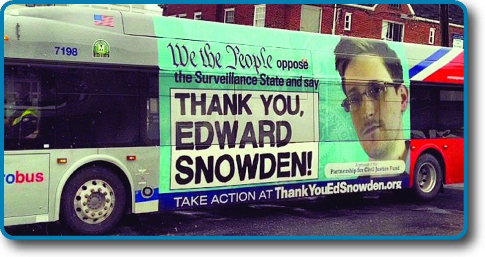 "A photo of the side of a public bus. An advertisement on the side of the bus reads ""We the People oppose the Surveillance State and say Thank you, Edward Snowden! Take action at ThankYouEdSnowden.org""."