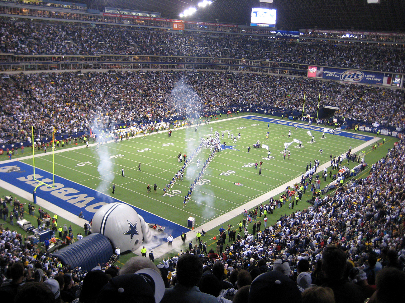 A photograph shows the inside of the stadium during a Dallas Cowboys football game.