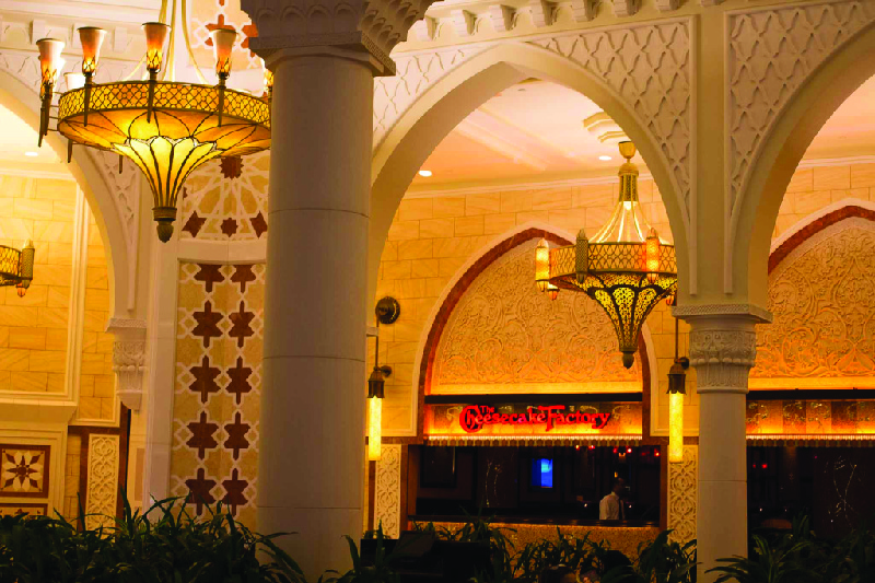 This image shows a Cheesecake Factory restaurant located in a mall in Dubai.