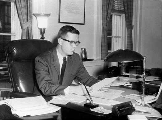 Theodore Sorensen reads a document at his desk.