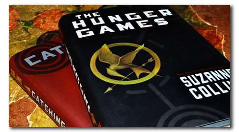Two of the books in Suzanne Collins' Hunger Games trilogy are shown here.