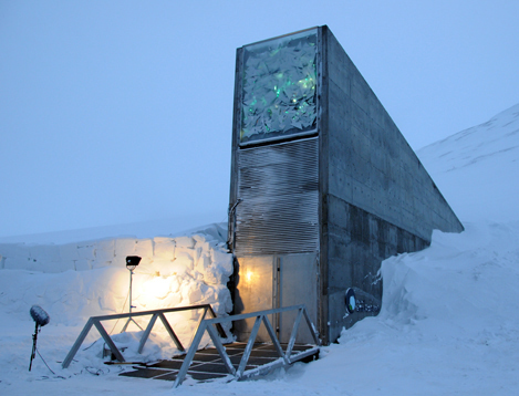 The photo shows a tall structure with a bunker-like door that disappears into a snowbank.