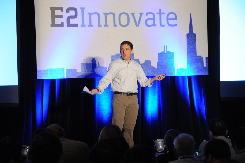 A photograph shows Ben Fried on stage, with a banner behind him that reads, E 2, innovate.